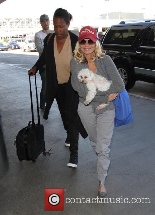 Kristin Chenoweth departs on a flight from Los...