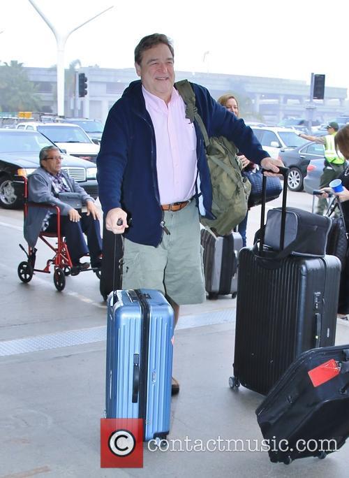 John Goodman departs on a flight from LAX