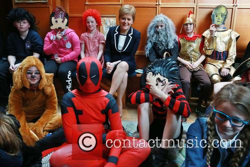 Scotland's First Minister Nicola Sturgeon with pupils from...