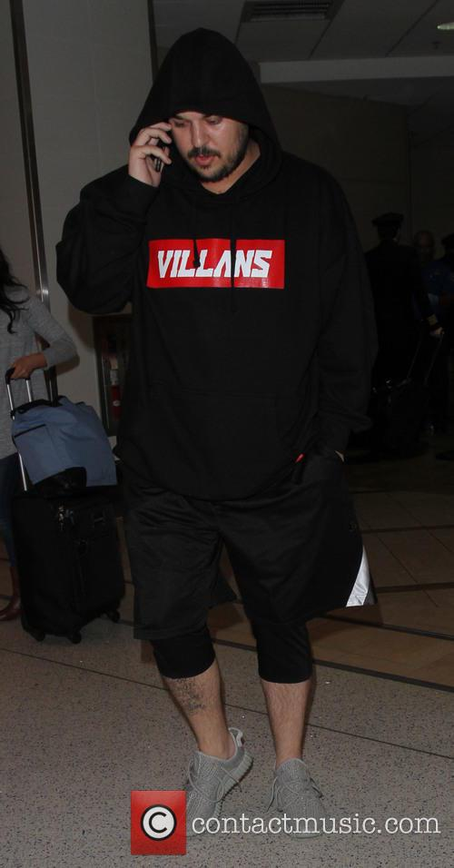 Rob Kardashian arrives at LAX with girlfriend Blac...