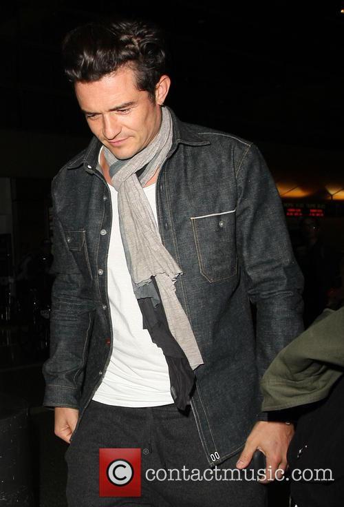 Orlando Bloom arrives at Los Angeles International (LAX)...