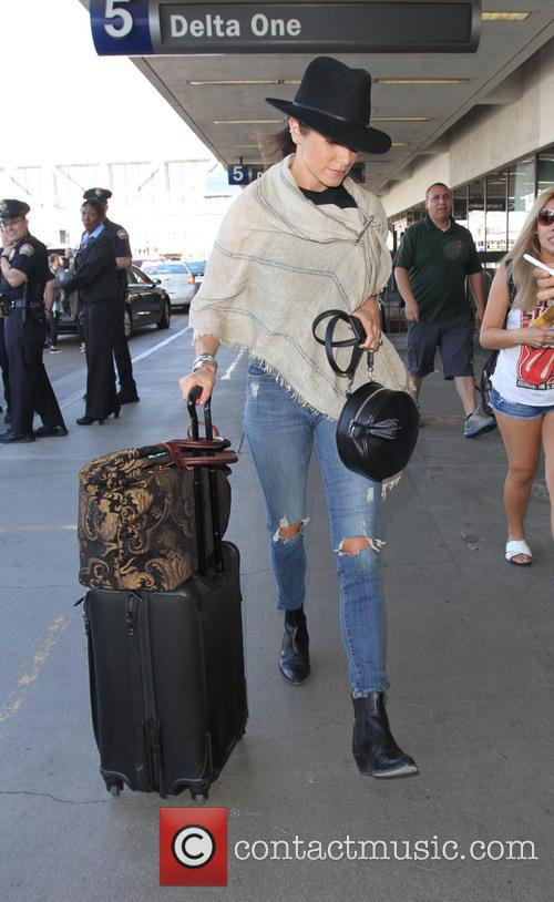 Nikki Reed departs from Los Angeles International Airport...