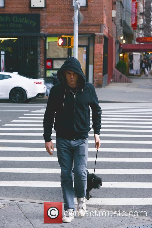 Michael C. Hall walking his dog in the...