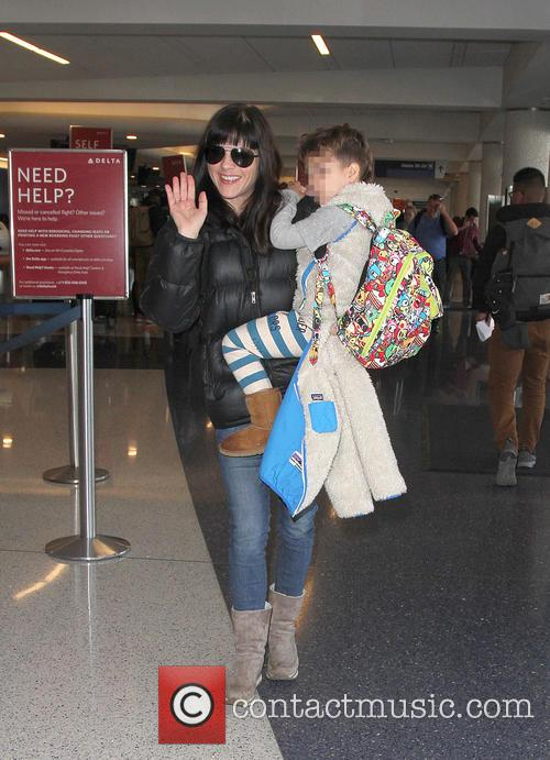 Selma Blair arrives at Los Angeles International Airport...