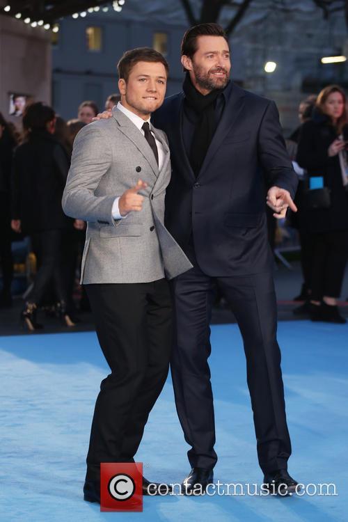 Taron Egerton and Hugh Jackman