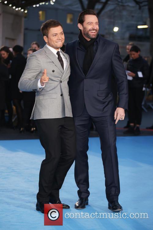 Taron Egerton and Hugh Jackman 8