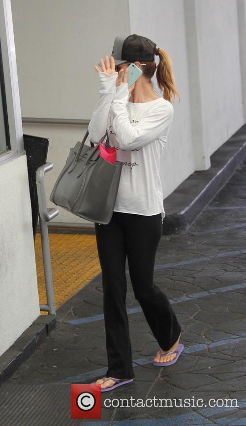 Actress Lori Loughlin seen paying the parking valet...