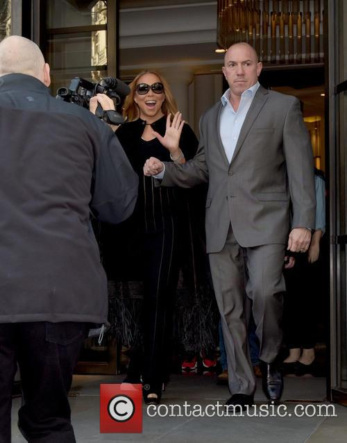 Mariah Carey leaves the Corinthia Hotel and signs...