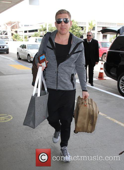 Todd Chrisley arrives at LAX with his wife...