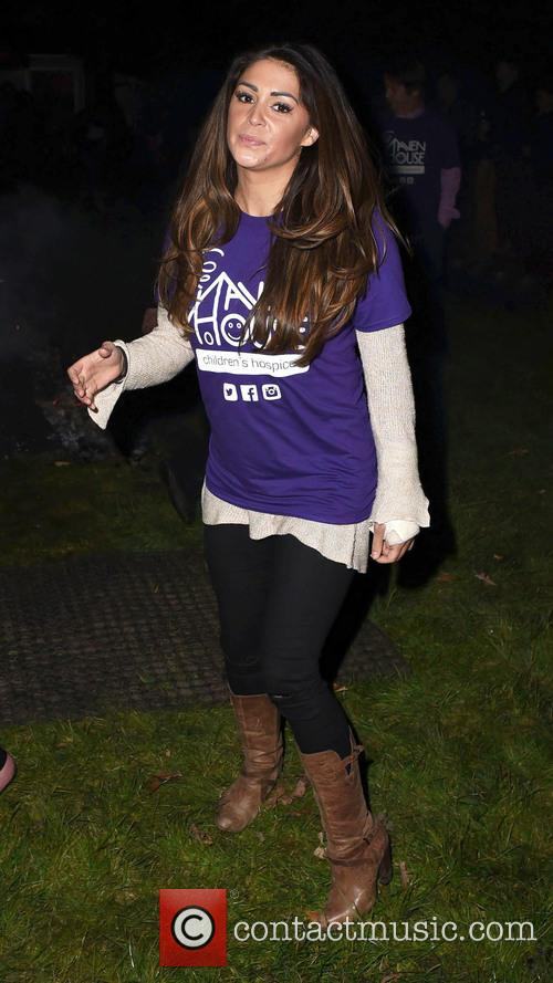 Casey Batchelor does a Fire Walk for Heaven...