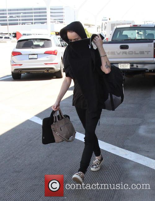 Taryn Manning hides her face upon arrival at...