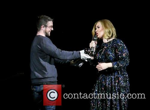 Adele wins an award whilst on stage in...