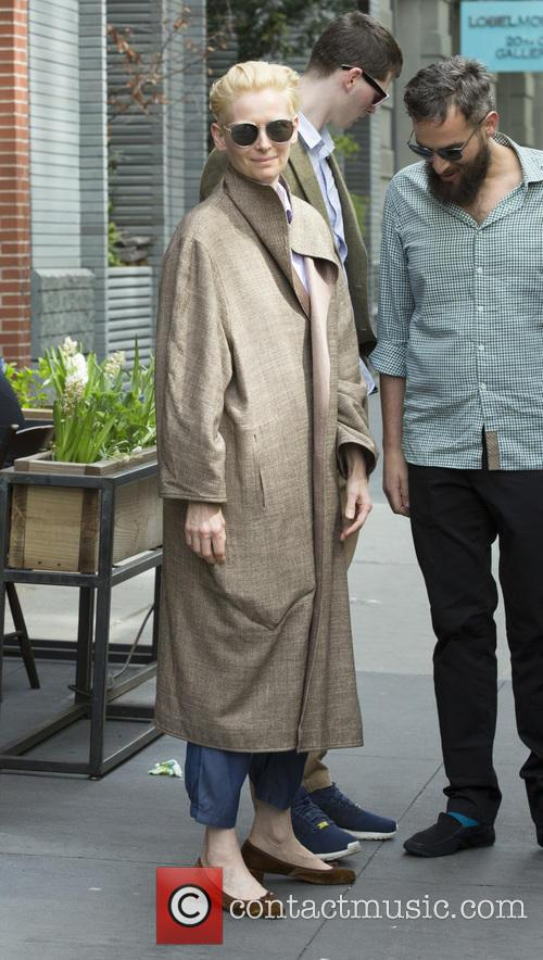 Tilda Swinton and Sandro Kopp out and about...