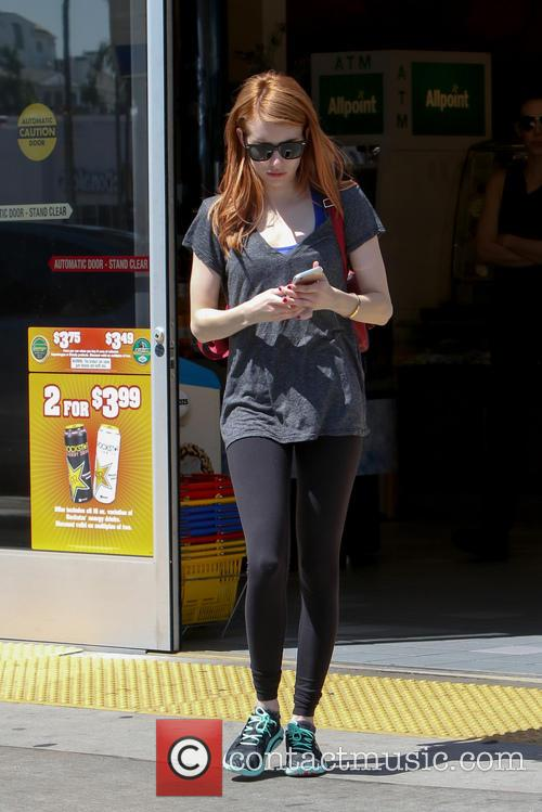Emma Roberts seen filling-up gas at a gas...