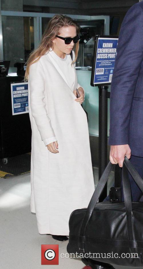 Mary-Kate Olsen arrives at Los Angeles International Airport...