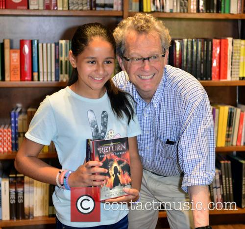 Author Ridley Pearson signs copies of his book...