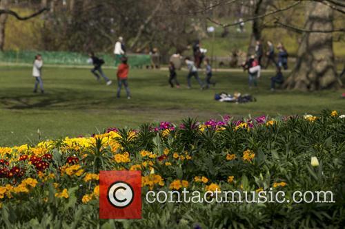 People enjoying the sunshine in St. James's Park
