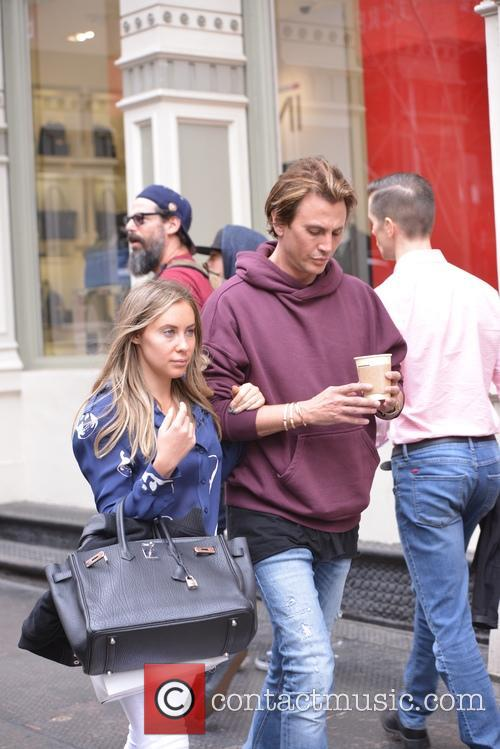 Jonathan Cheban and female friend out in Soho