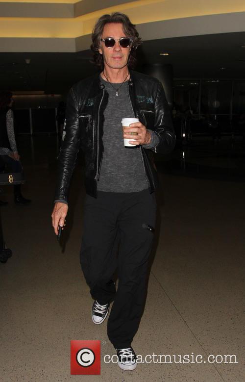 Rick Springfield arrives at Los Angeles International (LAX)...