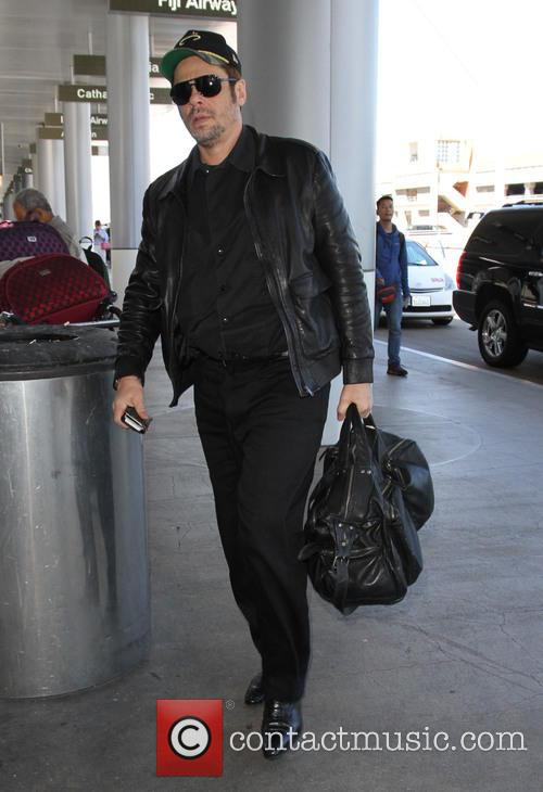 Benicio del Toro arrives at Los Angeles International...
