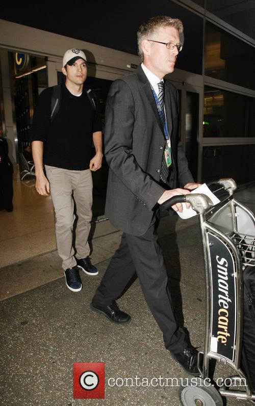 Ashton Kutcher arrives at Los Angeles International Airport...