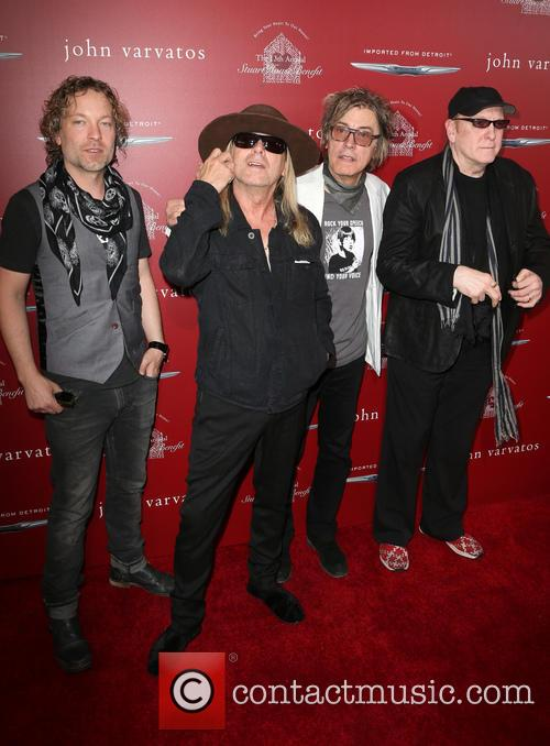 Daxx Nielsen, Robin Zander, Tom Petersson and Rick Nielsen 9