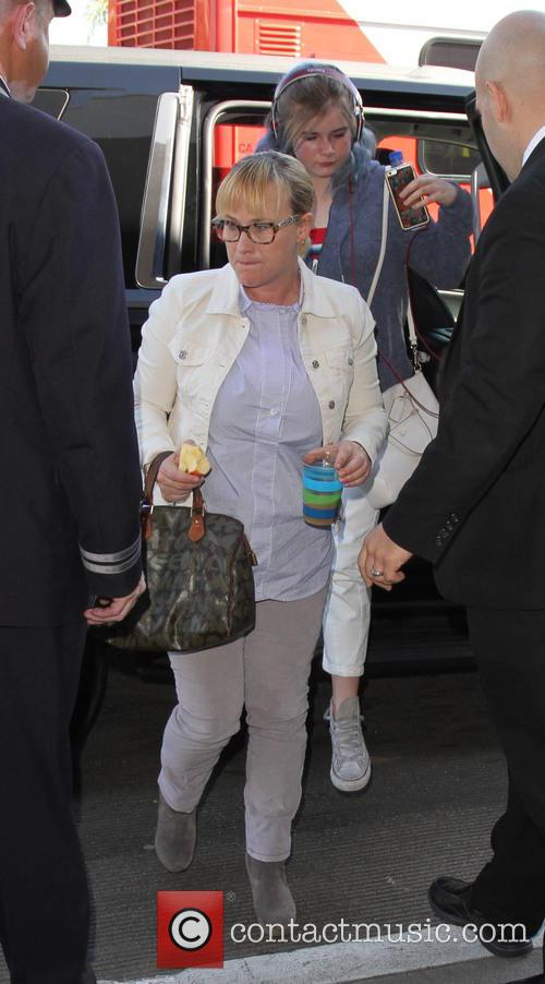 Patricia Arquette arrives at LAX with her daughter