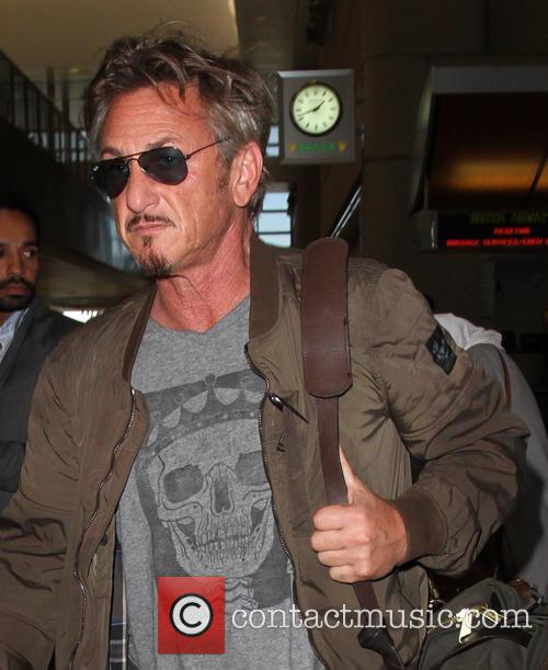 Sean Penn leaves on a flight for Paris...