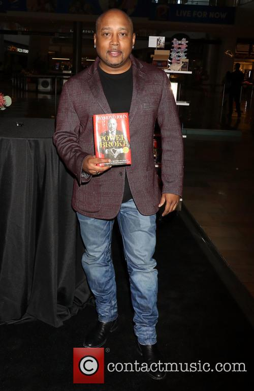 Daymond John signs copies of 'The Power Of...