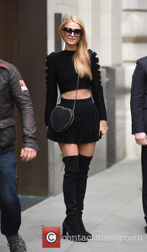 Paris Hilton leaving her hotel in a stunning...