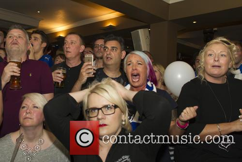 Fans watch Leicester City v Manchester United at...