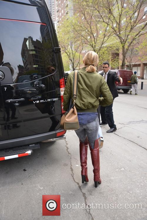 Kate Hudson in thigh high boots in New...