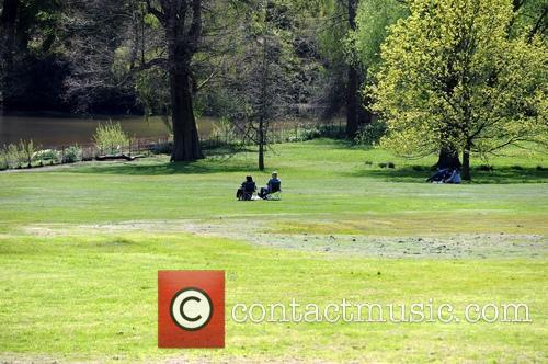 People enjoying the warm spring sunshine on Hampstead...