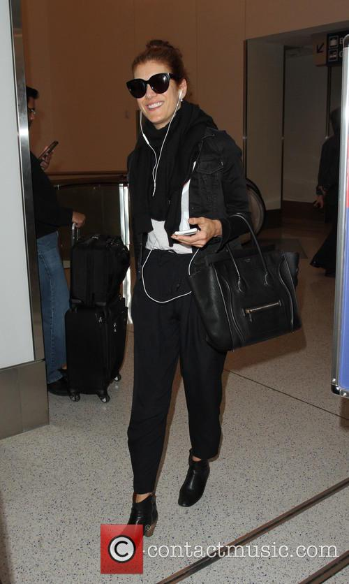 Kate Walsh arrives at Los Angeles International Airport...