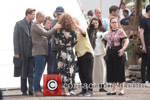 Brad Pitt and Lizzy Caplan filming scenes for...