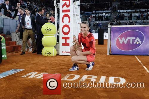 Mutua Madrid Open - Simona Halep celebrates her...