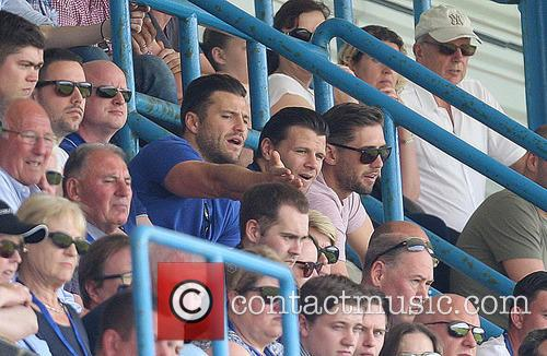 Mark Wright watches his brother Josh play for...