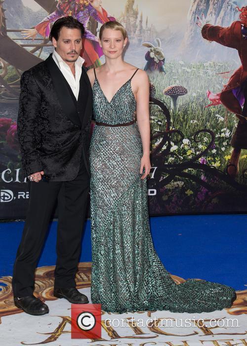 Mia Wasikowska and Johnny Depp 7
