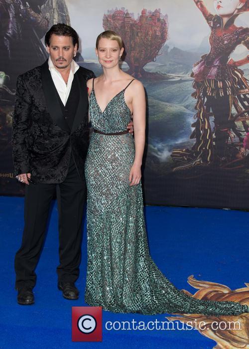 Mia Wasikowska and Johnny Depp 11