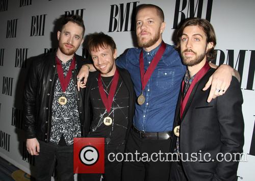 Imagine Dragons, L-r Daniel Platzman, Ben Mckee, Dan Reynolds and Daniel Wayne Sermon
