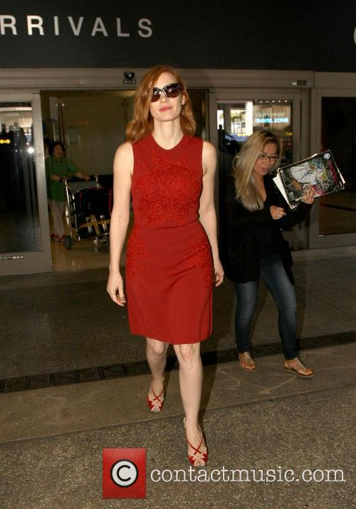 Jessica Chastain poses for photos with fans as...