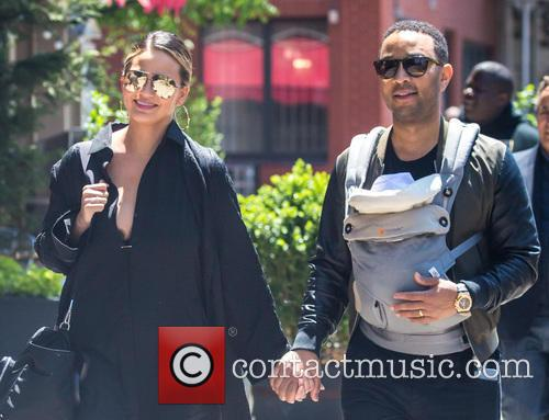 Chrissy Teigen and John Legend enjoying a stroll...