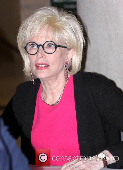 Author Lesley Stahl signs copies of her new...