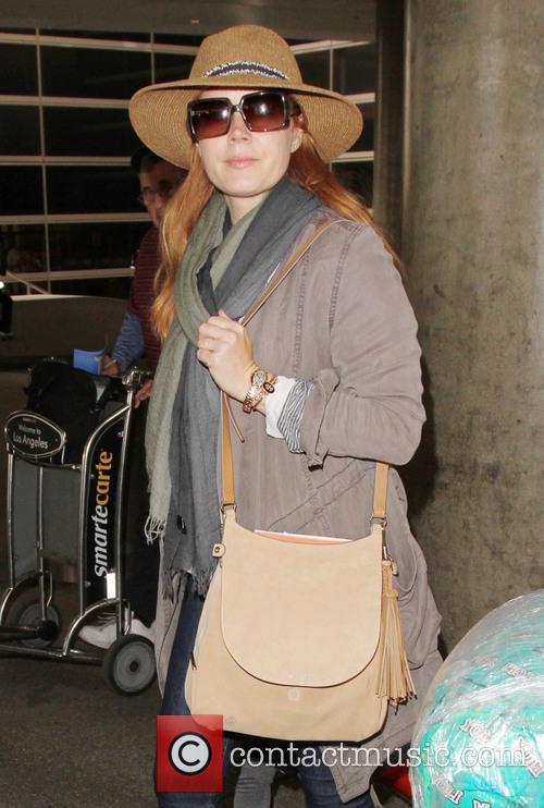 Amy Adams and her daughter arrives at Los...