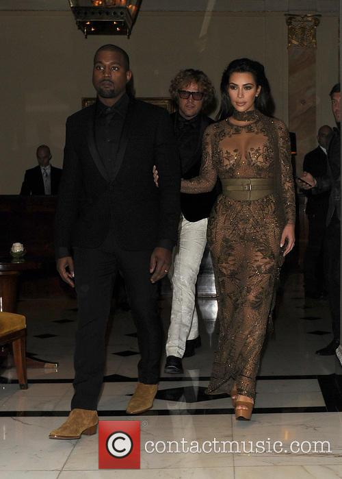 Kim Kardashian and Kanye West leave their hotel...