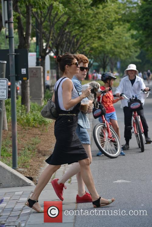 Helena Christensen and a friend walk her dog...