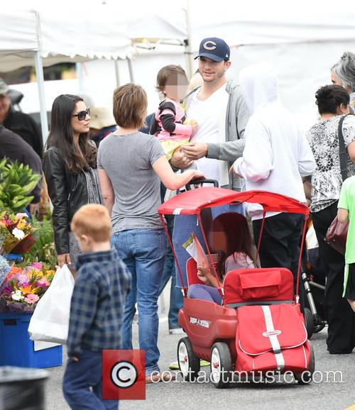 Ashton Kutcher and Mila Kunis at the Farmers...