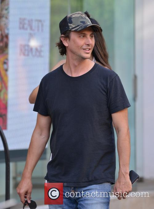 Jonathan Cheban walking with friends in SoHo
