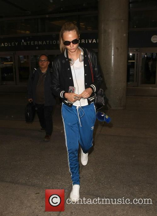 Cara Delevingne greeted by St. Vincent at LAX