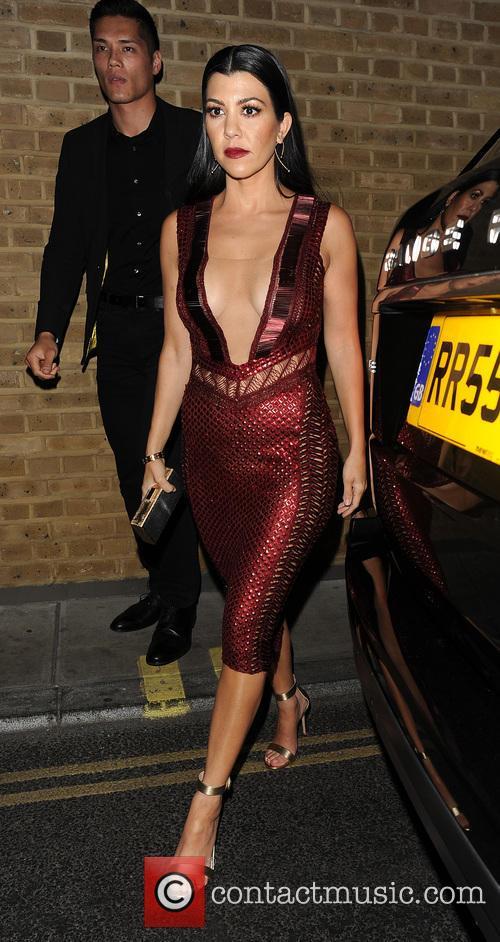 Kourtney Kardashian returns to her hotel, having attended...